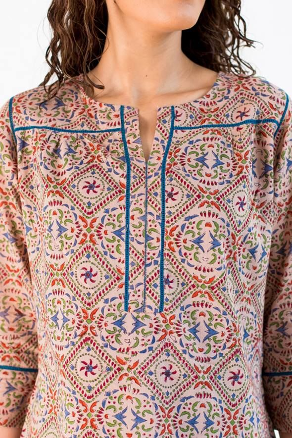 A hand block print top with interesting style details in its cut , it fits very well and can be paired with jeans or jeggings. Hand block printed cotton malmal fabric is very soft to the touch and fits perfectly on the body. 100% cotton fabric from Bagru, Rajasthan.