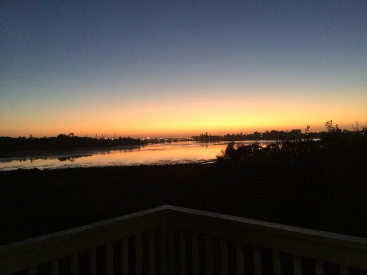 View off inner harbour at sunrise from our veranda in Tauranga, New Zealand