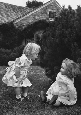 With the doll leaning slightly back and her hair looking like it does, it looks like this little girl is blowing the doll over with her verbal assault - too funny!