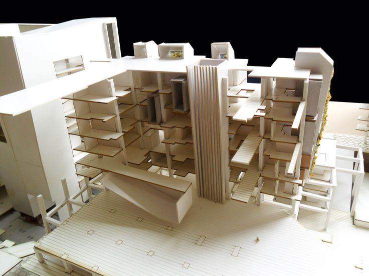 Modelo en corte en torre norte intervención residencial estudiantil + Auditorio colgante + Dptos. de uso mixto.