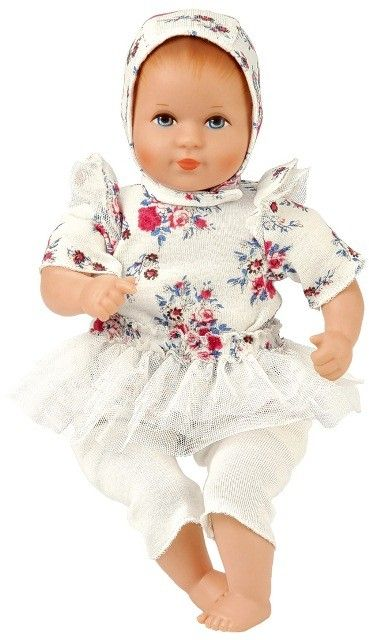 Made in Germany, Kathe Kruse Mini Bambina Stella is fashioned from high quality hard vinyl and has a soft cloth body filled with synthetic granules. The arms and legs dangle, and the head - like a real baby - rests gently in your arms. #kathekruse #dolls