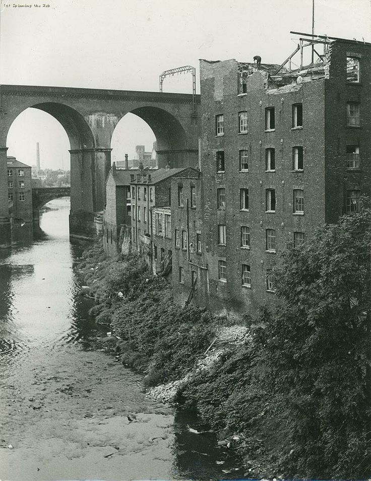 Demolition of Lower Wellington Mill facing towards the Stockport railway viaduct, Stockport, Manchester, UK, 1973, photograph by H. Lee.