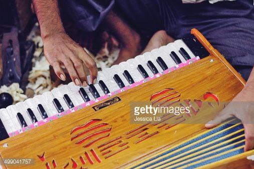 Stock Photo : Man playing harmonium