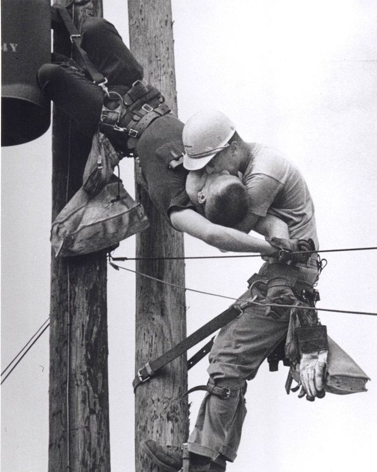 Taken in 1967 by Rocco Morabito, this is one of the most powerful photographs we've seen. Called the Kiss of Life photo, it shows a utility worker named J.D. Thompson giving mouth-to-mouth to co-worker Randall G. Champion after he went unconscious following contact with a high voltage line.