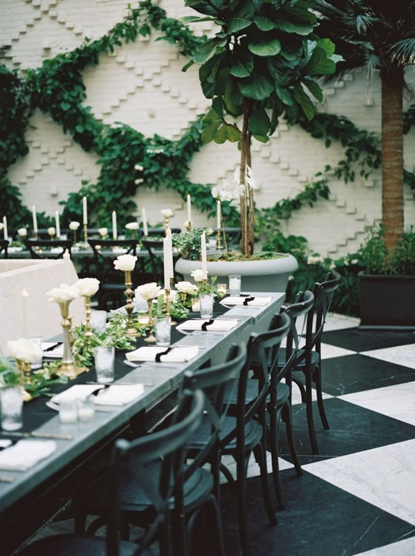 courtyard wedding reception in black, white, and green | Kristin Sweeting
