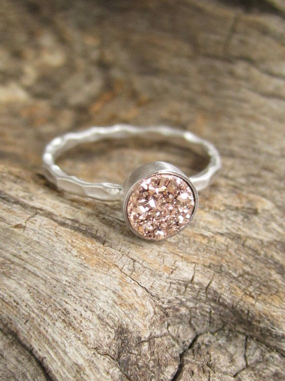 Gorgeous, rose gold colored druzy quartz stone is set inside a petite rhodium plated sterling silver hammered ring band (rhodium plated sterling