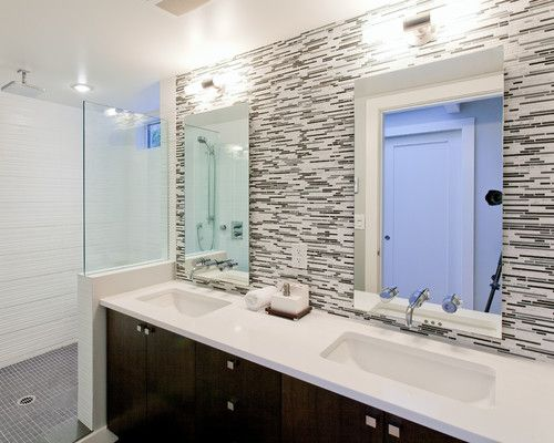 Bath With Full Wall Tile Splash. White Quartz Countertops With Dark Wood  Cabinets.