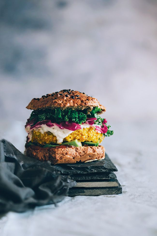 Spiced cauliflower burger, with sauerkraut, avocado and lemon-garlic Greek Yogurt | TheAwesomeGreen.com