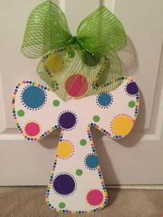 Painted wooden Cross Door Hanger with ribbon and dot design.