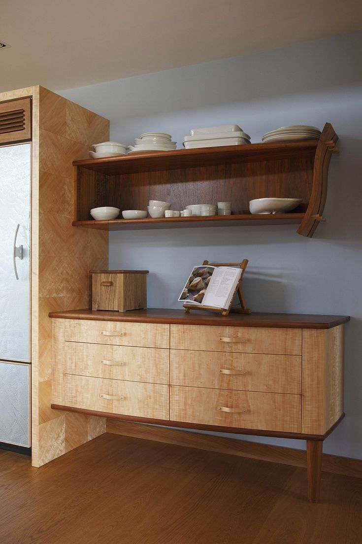 Traditional dresser next to the fridge gives the space a warm, cozy appeal