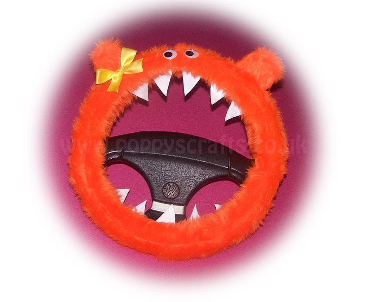 Cute fuzzy orange monster car steering wheel cover with cute yellow bow.  Googly eyes teeth and ears very cute waiting for you to adopt him/her http://ift.tt/1MdrObG  #fuzzy #orange #monstercover #steeringwheelcover #fluffy #furry #cute #carsofinstagram #handmade #wanelo #shopify #halloween #monster #carcover #googlyeyes #googlyeyesmakeeverythingbetter #bright #fauxfur #adoption #carbuddy #carinterior #truckaccessories #jeepaccessories #caraccessories