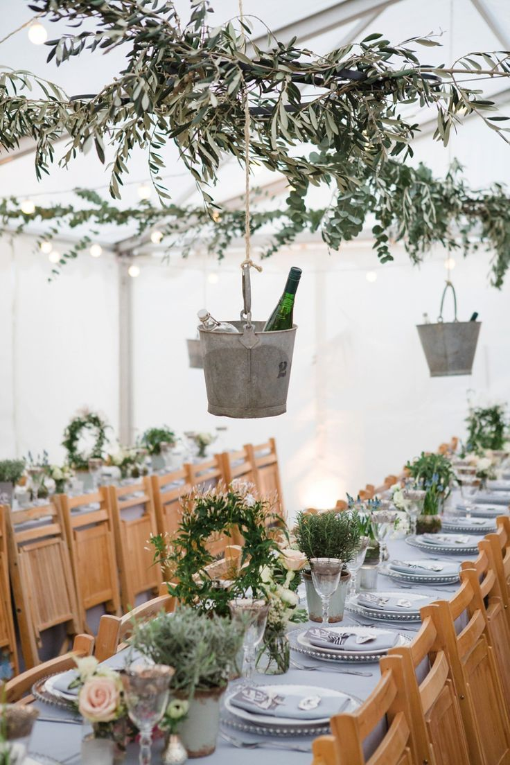 Garden table setting with lavender, eucalyptus and tin ice buckets  13 Bridesmaids for a Laid Back and Glamorous British Backyard Wedding | Love My Dress® UK Wedding Blog  Photography by http://cgpgraham.com & http://www.lucydavenport.co.uk