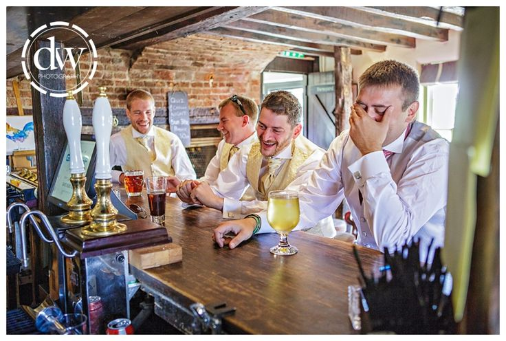 Groom and his Ushers in the Three Blackbirds before the wedding ceremony at The Granary Barns, Suffolk