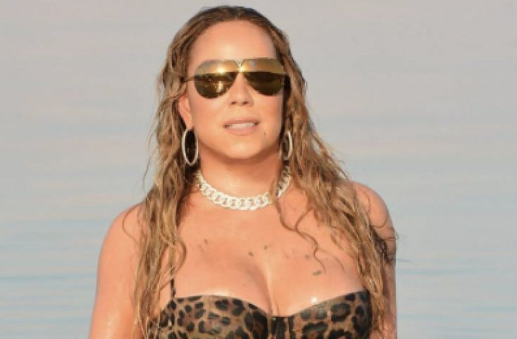 Mariah Carey flaunts cleavage in jaw-dropping leopard print bathing suit