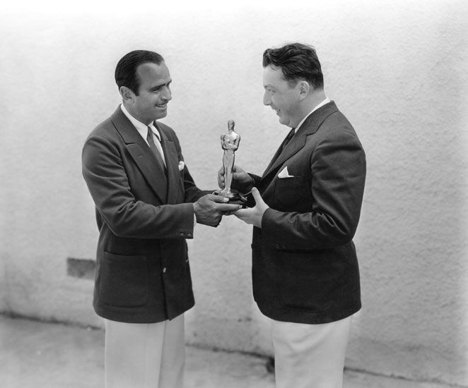 "Douglas Fairbanks presented Lewis Milestone with the Academy Award for Directing – Comedy Picture (""Two Arabian Knights"")."
