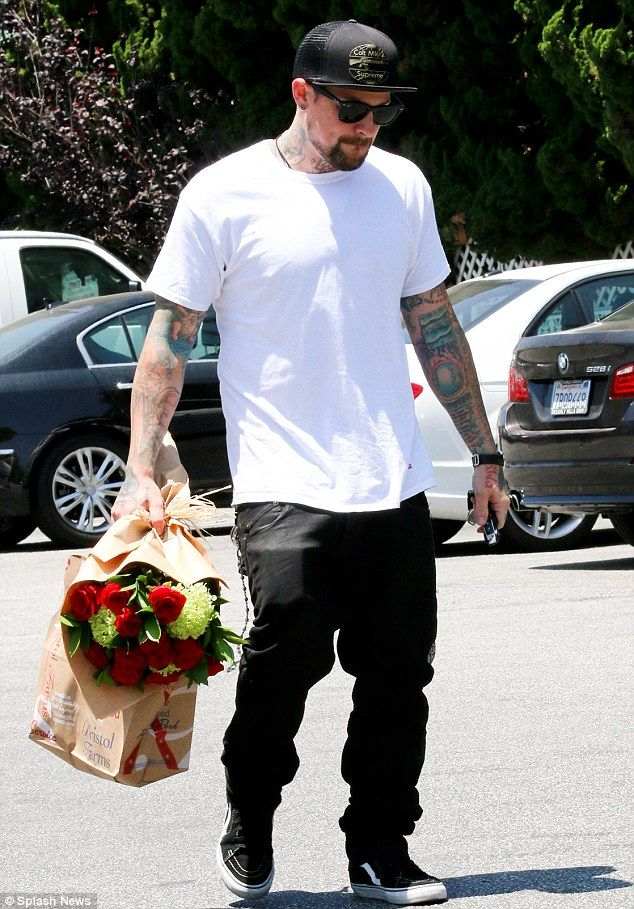 Chivalrous: Cameron Diaz's boyfriend Benji Madden was spotted buying a rose bouquet from B...