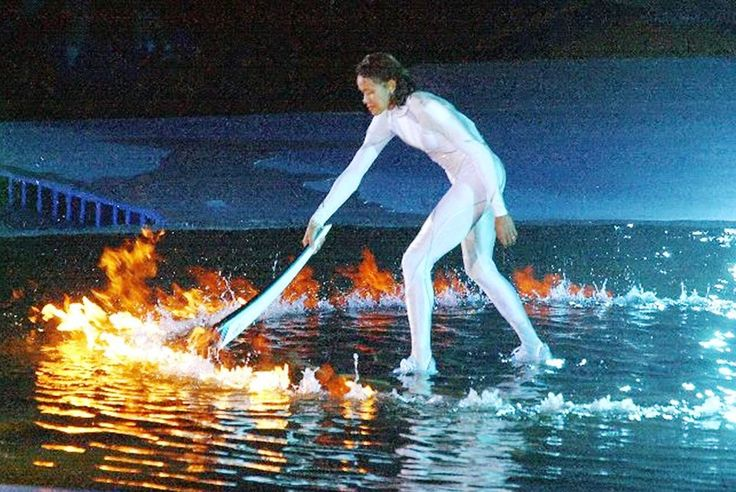 Australian athlete Cathy Freeman lights the Olympic flame to complete the opening ceremony of the 2000 Sydney Olympic Games at Stadium Australia, Olympic Park, Homebush.