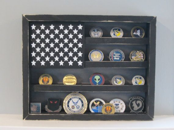 In Stock! Ready to Ship!!! SIZE: 15in Tall x 12in Wide x 2.5in Deep Holds approximately 18 - 25 Challenge Coins depending on the size of the coins. Accommodates coins as large as 2.5 in diameter on the bottom shelf and 1.5 in diameter on the top shelves. Coin Slots are 3/16 wide and will fit standard Military Challenge Coins. Coins thicker than 3/16 will not fit in the slots. Awesome addition to Your Man Cave to display all those Military Challenge Coins that you've been collecting. This ...