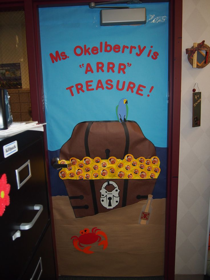 "I created this door for the teacher because her whole room was pirate themed. I free handed the chest. I used  the Cricut Machine for the letters, lock, parrot, crab, and bottle. I printed several pictures of the teacher making her the ""treasure""."