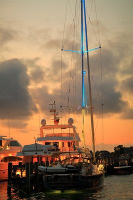 Yacht, lit up by the setting sun on the harbour of Nantucket