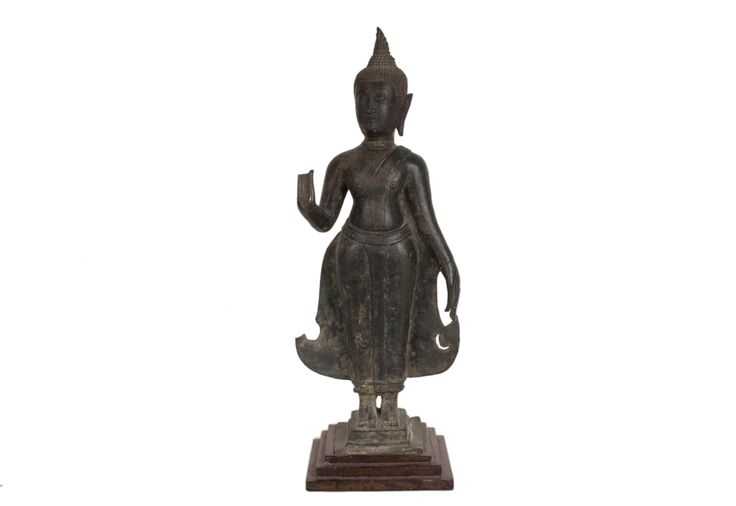 Description A bronze standing figure of Buddha Thailand, his right hand raised in abhaya mudra  Date 16th/17th century  www.collectorstrade.d