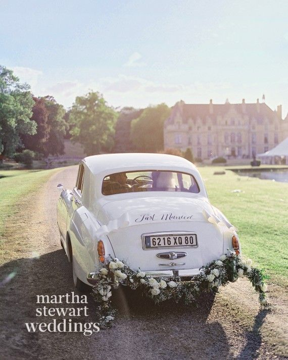 The bride arrived in a retro ride: a Rolls-Royce decorated with an ivy and hydrangea garland.