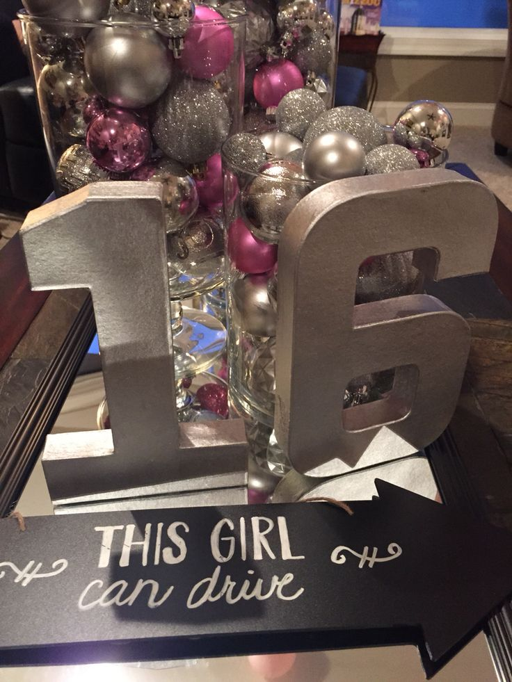 Sweet 16 table decor - pink and silver Christmas ornament balls in a variety of glass vases.  Add a sliver number 16 and a full length mirror as a table runner.