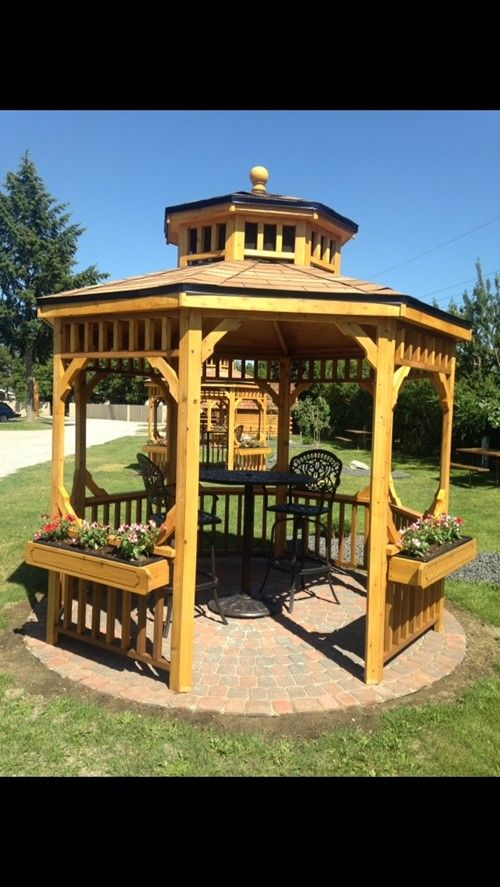 A gorgeous gazebo with pub style table, hand laid paver patio & landscaping make this an ultimate site at the Spokane KOA Journey