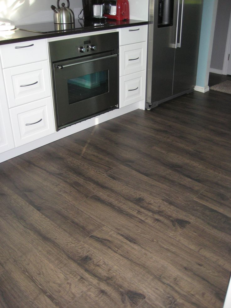 Quick step reclaime flint oak laminate flooring photo for Quickstep kitchen flooring