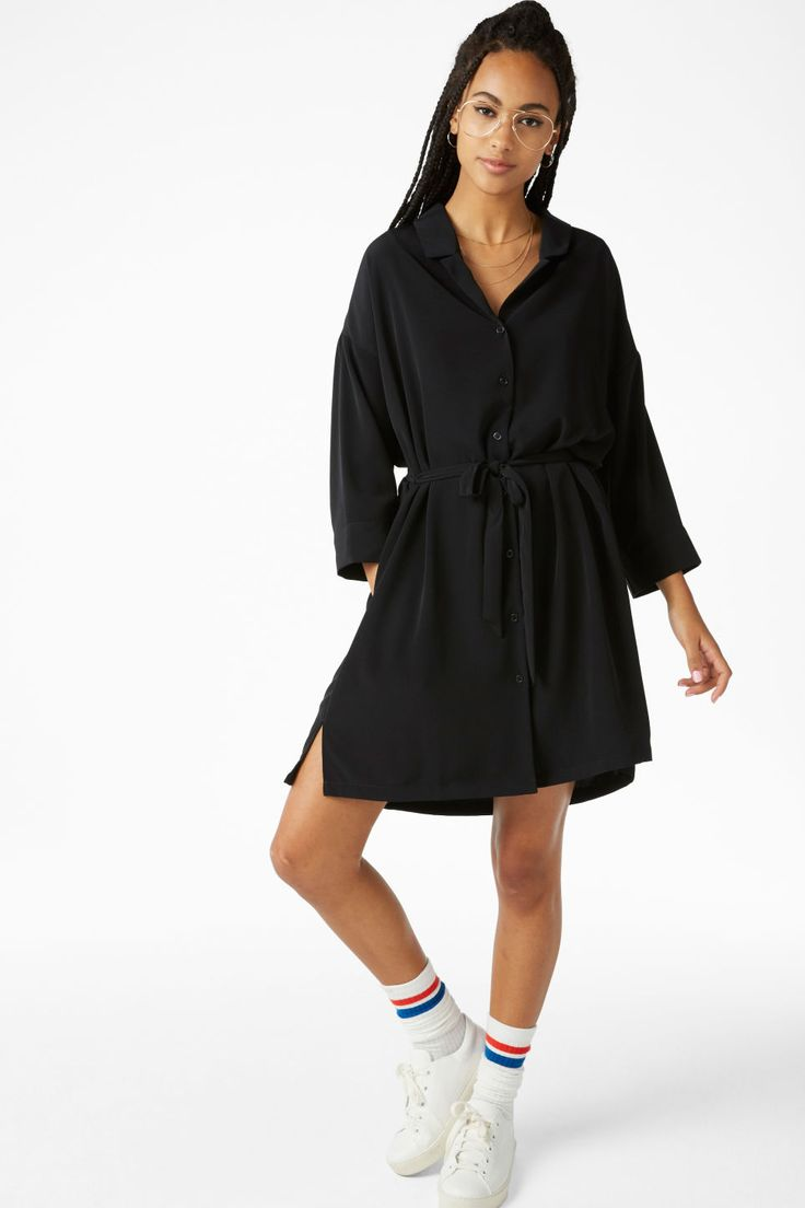 A classy knee-length shirt dress that ties in the waist. Super-soft 'n' flowy with neat pockets hidden in the side seams. Yaas! In a size small the chest w