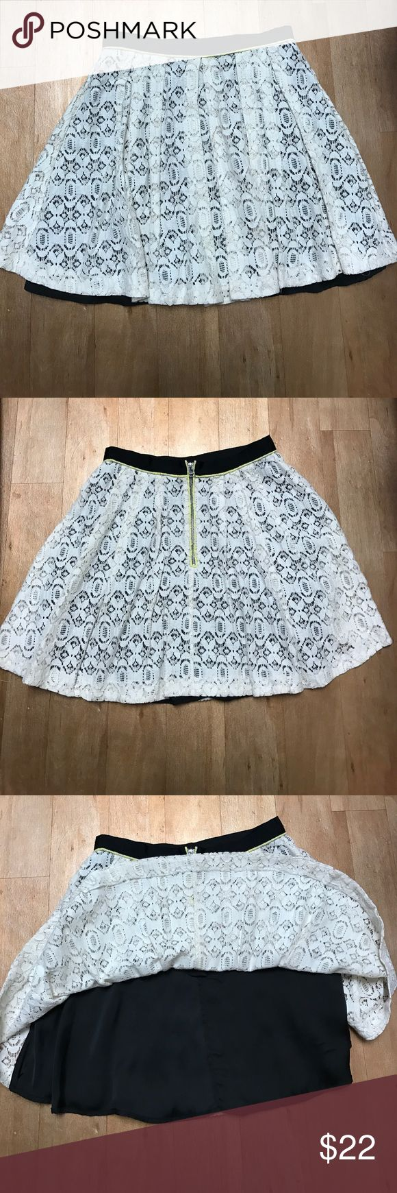 Walter Baker Lace Cream Skirt with Black Lining Walter Baker Lace Cream Skirt with Black Lining. Neon Yellow Detailing. Worn once. Great condition. Size Small. Feel free to make an offer! Walter Baker Skirts