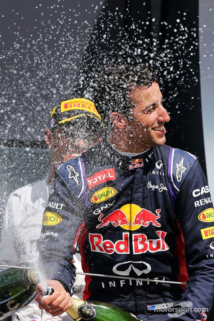 Daniel Ricciardo celebrating on the podium - 2014 British GP