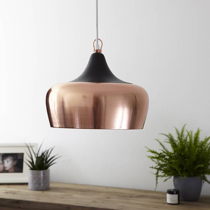 A stylish, contemporary pendant light that would suit any modern country interior. <em><strong>ONLY ONE LEFT IN STOCK</strong></em>Finished in a beautiful rose-gold brushed metal with a snug fitting integral lid in black resin, its clean elegant shape will look stunning in a kitchen diner above an island or table. The fashion for metallic accents looks destined to become a design classic and this addition gives a chic acknowledgment to the trend for a sophisticated look. The pendant light…