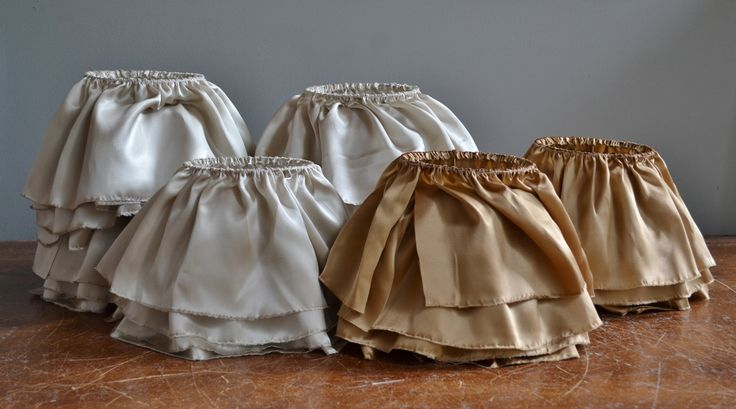 Half finished lampshades - like pretty maids all in a row.