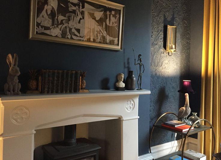 Living room fire place. Dark interior with Lincrusta wallpaper.