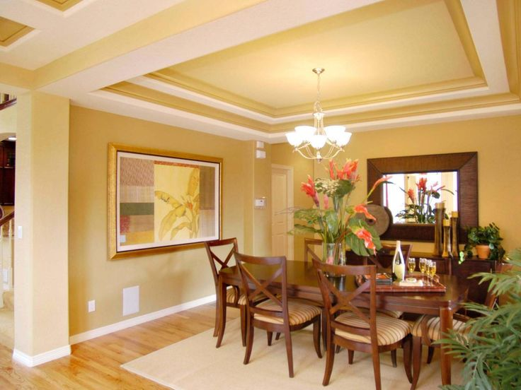 Architectural Drama Compartmentalizes The Dining Room While Contrasting Colors Highlight Coffered Ceiling Design Space Is Filled Nicely With