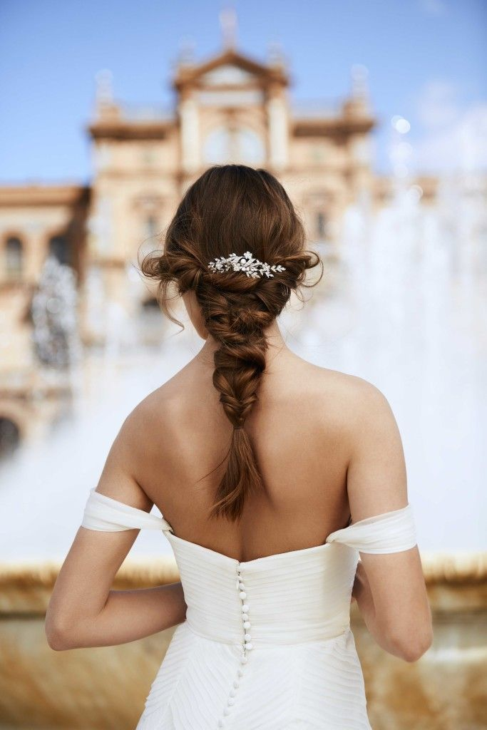 Wedding Day Hairstyles and Inspiration - we love a braid with some hairpiece detail that leaves a sparkle wherever you go. Wedding dress and hair accessory by international designer, Pronovias