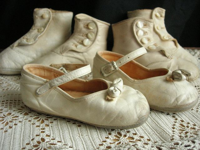 antique white baby shoes.