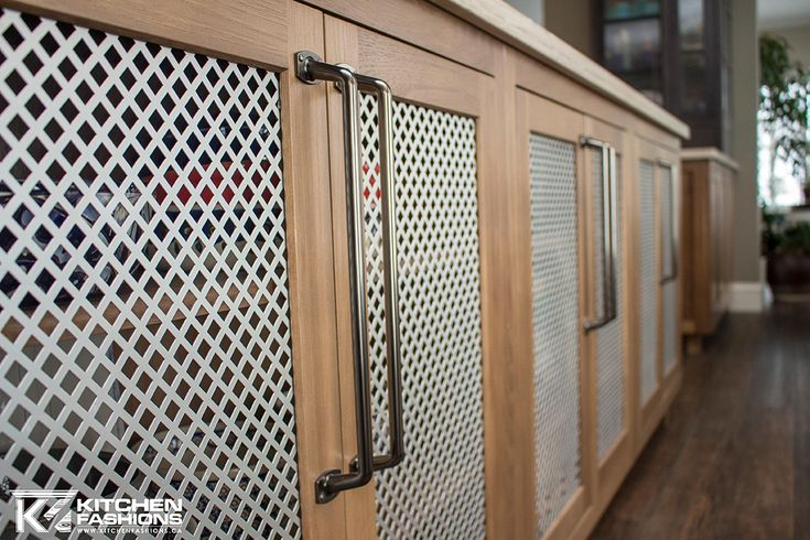 Over sized charcoal hardware from Amerock with metal screen doors on Hickory cabinets.