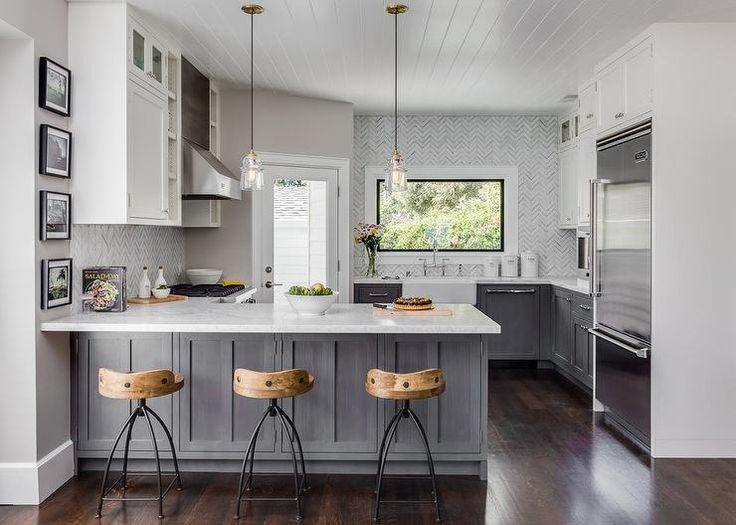 White And Gray Kitchen Features Gray Distressed Cabinets Paired With White  Marble Countertops And A White