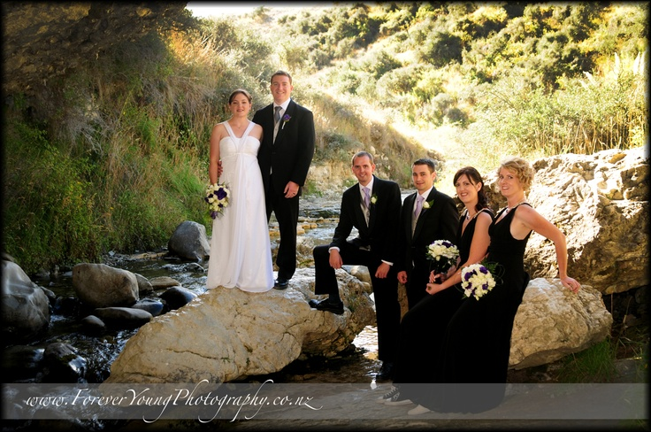 Wedding by a stream..cave entrance near Castle rock in the South Island in New Zealand  www.ForeverYoungPhotography.co.nz
