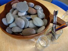 A simple & fun activity for the Early Years with stones & water - great for fine motor skills.
