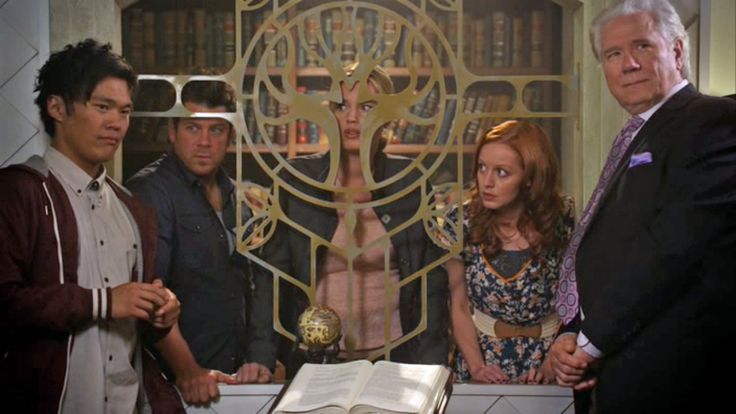 John Kim (Ezekial Jones), Christian Kane (Jacob Stone), Rebecca Romijn (Eve Baird), Lindy Booth (Cassandra Cillian) & John Laroquette (Jenkins) - The Librarian's and the Apple of Discord- screen cap