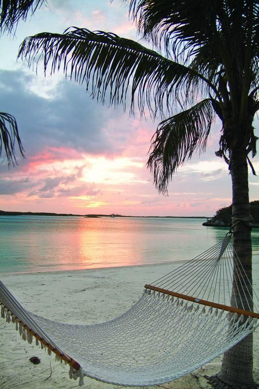 A Summer Paradise Hammock On The Beach With Sunset Over Ocean