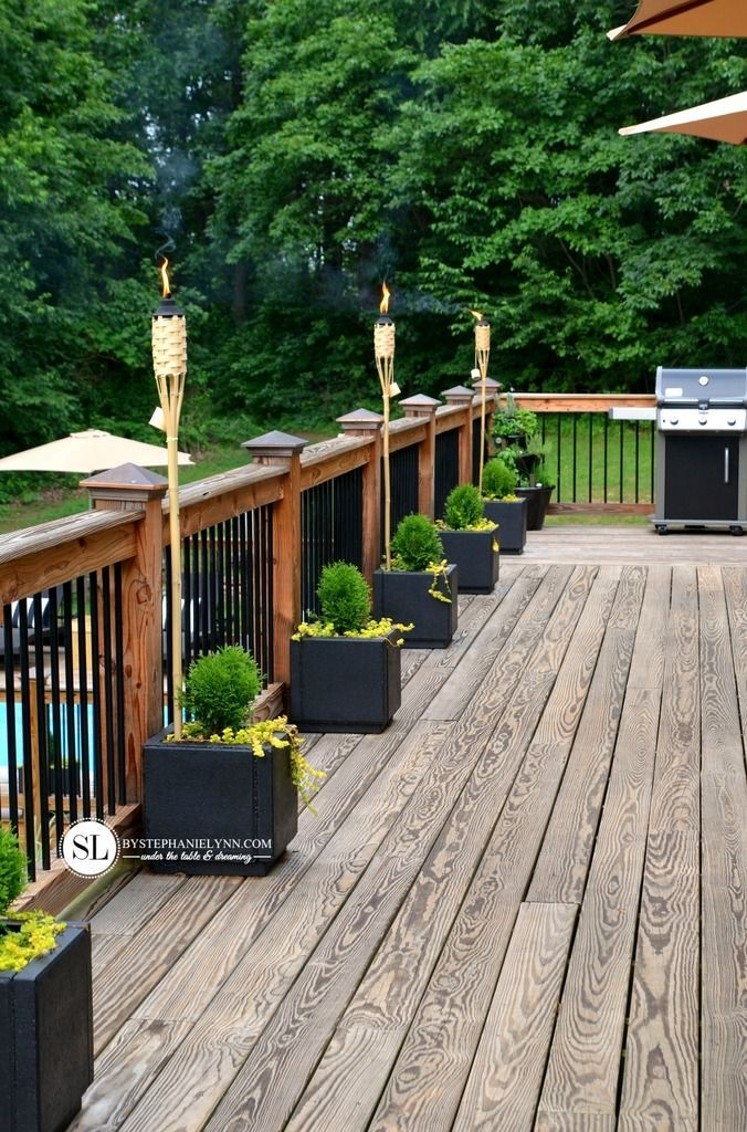 DIY Party Deck Decor | Create a inviting party ambiance with TIKI Brand torches. #summer #deck #entertaining