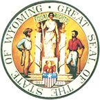 """The Great Seal of the State of Wyoming: The dates on the Great Seal, 1869 and 1890 commemorate the Territorial government and Wyoming's admission to the Union. The draped figure in the center with the words, """"Equal Rights,"""" symbolizes the political status women have in Wyoming. The male figures typify the livestock and mining industries. The 44 on the five-pointed star signifies that Wyoming was the 44th state admitted to the Union."""