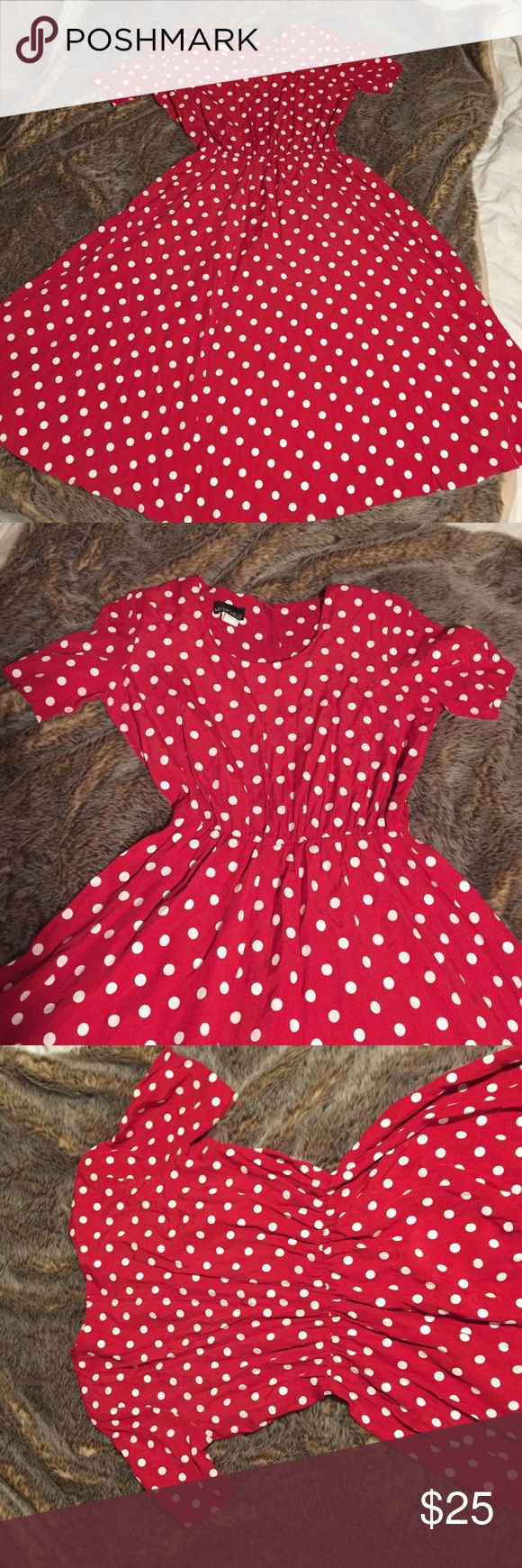 Retro pin up vintage polka dot dress Retro pin up vintage polka dot dress. Has small shoulder pads. Could leave in or snip the stings and remove if you don't like them. Great condition. Tag says 14 but could also fit smaller because the elastic waist is pretty small, but also stretches enough to fit bigger! My Michelle Dresses