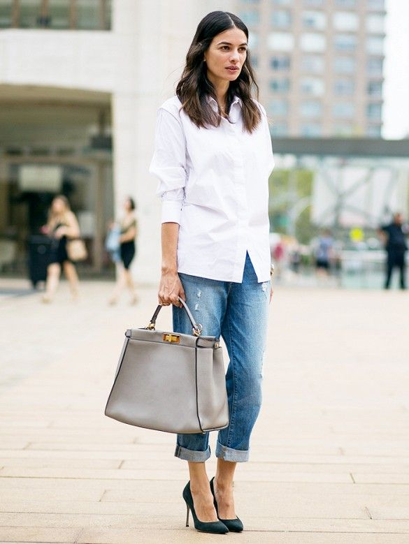 The ultimate on-the-go work outfit: Crisp button-down shirt + cuffed jeans + structured tote + black pumps