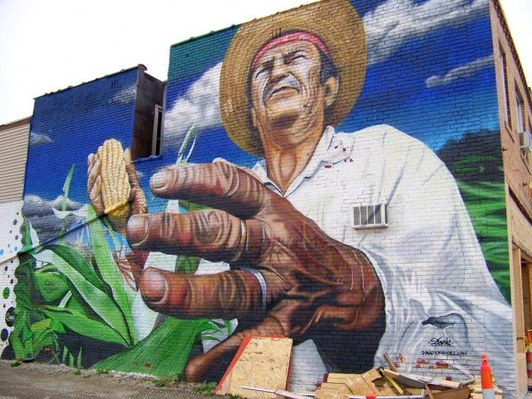 """""""Mano de Obra Campesina (Hand Of The Peasant Labor??)"""" aka """"Hijo del Maiz (Son Of Corn)"""" by Dasic Fernandez (2010); Located on the west wall of Hacienda Mexican Foods at 6022 West Vernor Highway, just east of Livernois Avenue, Detroit, Michigan."""