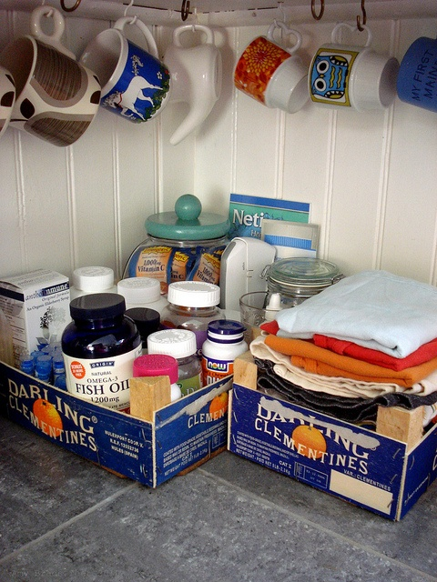 old clementine boxes as vitamin and dish towel storage...I love a good upcycle!